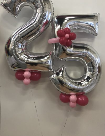 number balloons with helium and flower and collar