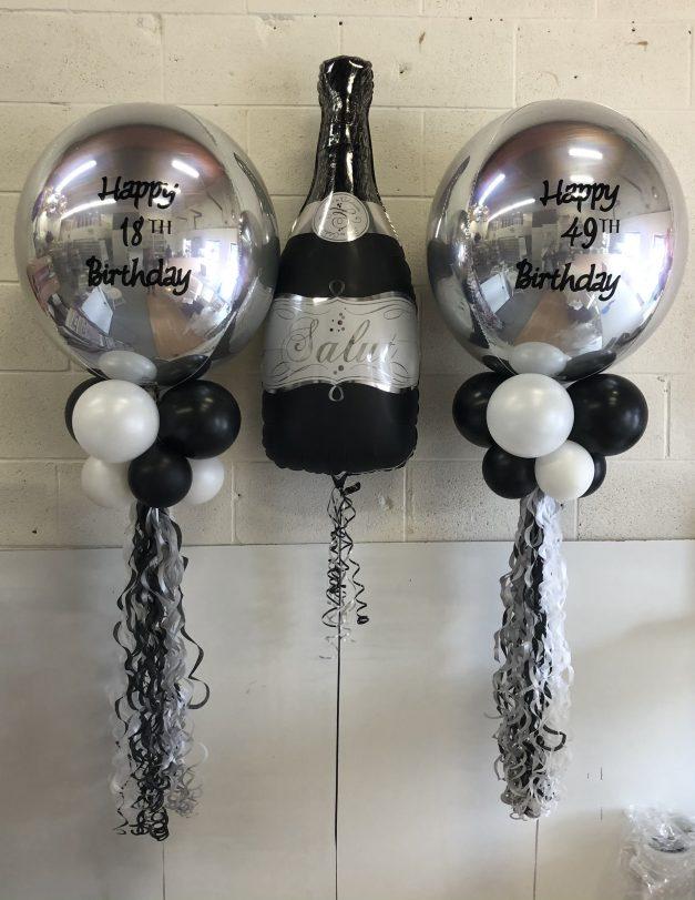 custom balloon orbz with champange bottle