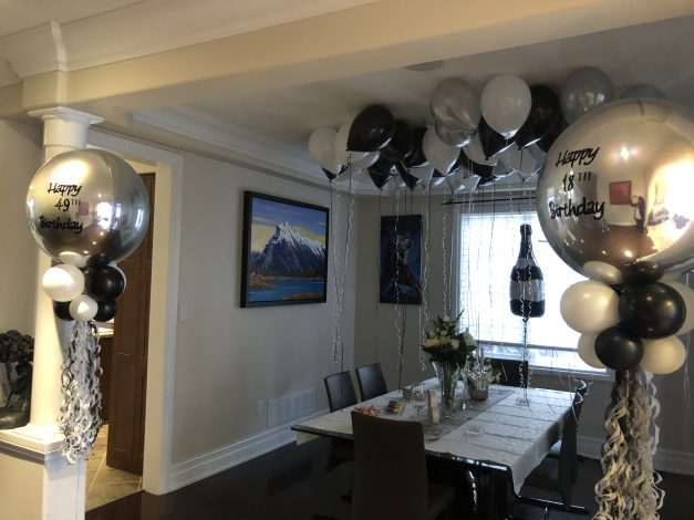 custom balloon orbz with tassels champange bottle and ceiling balloons