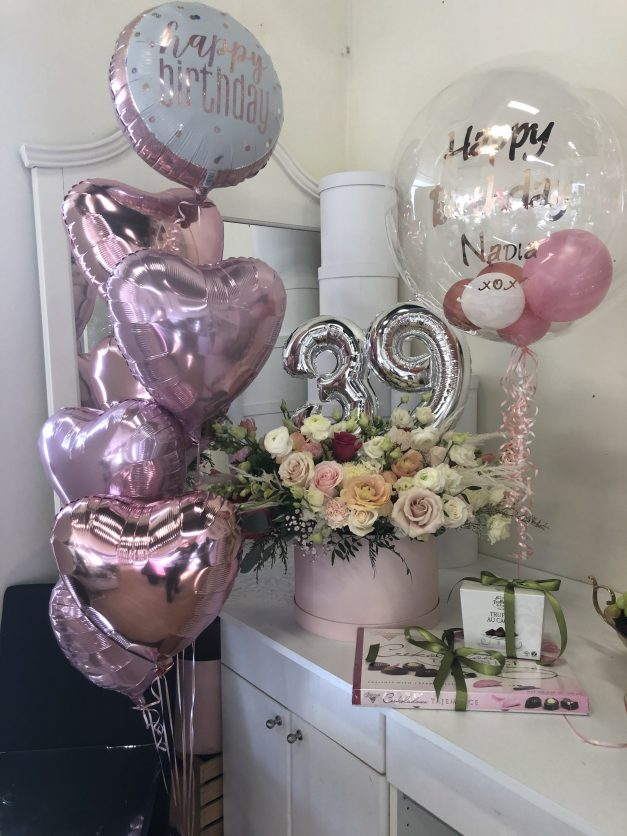 Pink package group of 7 custom balloon chocolates and flowers